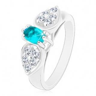 Lesklý prsteň v striebornom odtieni, ligotavá mašlička s modrým oválom - Veľkosť: 52 mm