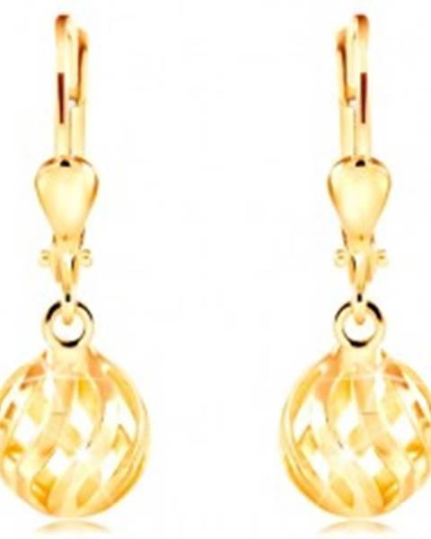 Náušnice zo žltého 14K zlata - ligotavá dutá guľôčka so zvlnenými výrezmi