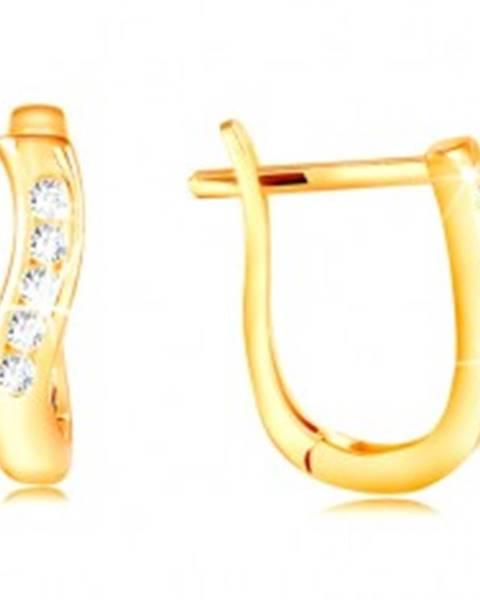 Zlaté náušnice 585 - lesklá zvislá vlnka zo žltého zlata, pás čírych zirkónov